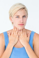 Woman with throat pain looking at camera