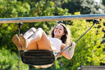 Young woman on swing