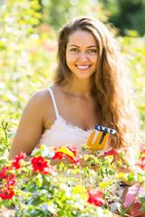 Female florist in summer garden