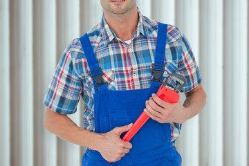 Image of plumber holding monkey wrench