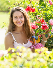 Woman working in roses plants