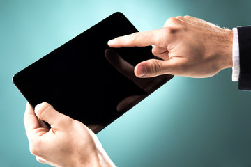 Hand touching the tablet