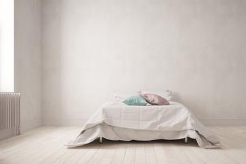 Schlichtes Schlafzimmer mit Bett an Wand