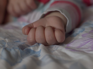 Hand of a small child.