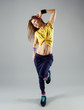Pretty woman with athletic body exercising zumba aerobics