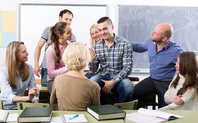 Teacher and happy adult students
