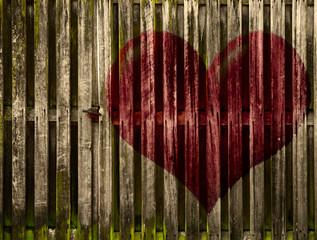 Door in wooden Fence with Painted Heart