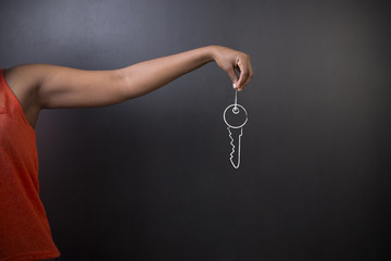 African American woman teacher holds key