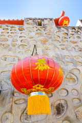 Chinese style stone wall and red paper lantern.
