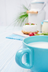 mug with milk on vintage table