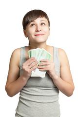 Портрет молодой счастливой женщины с деньгами в руках.