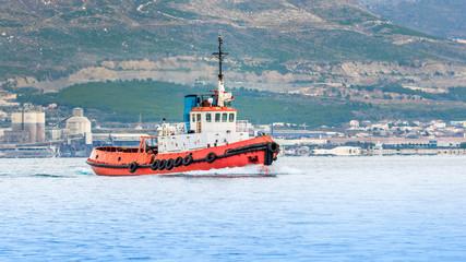 Red Tugboat on a sea