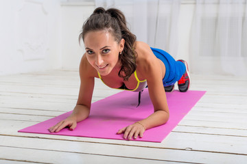 fitness training athletic sporty woman doing plank exercise on a
