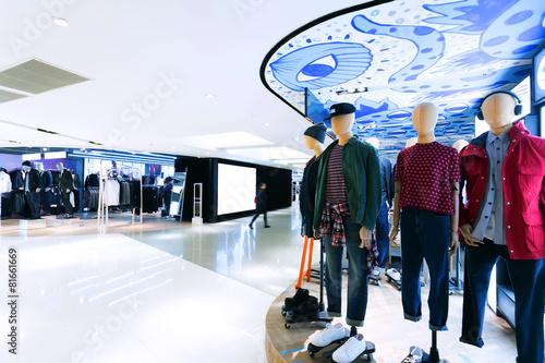 Leinwanddruck Bild fashion clothes shopfront in shopping mall