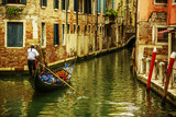 Fototapeta Venice, Italy - Gondolier and historic tenements (filtered)