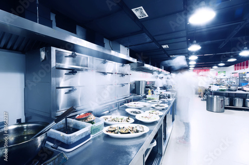 modern kitchen and busy chefs in hotel - 81662237