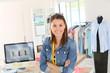 Leinwanddruck Bild - Portrait of smiling fashion designer in studio