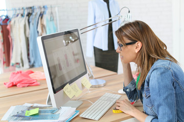 Fashion designer working in front of deskop computer