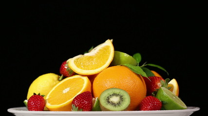 Fresh fruits on black background