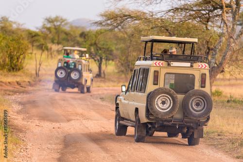 Leinwanddruck Bild Jeeps on african wildlife safari.