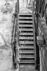 Black and white image of a worn and weathered staircase