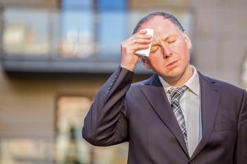 Stressed businessman having headache