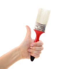 Red brush in female hand isolated on white