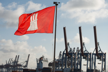 hamburg city flag on harbor cranes background