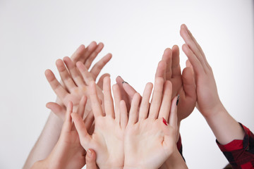 many hands reaching up