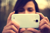 Portrait of beautiful young woman take a photo with mobile phone