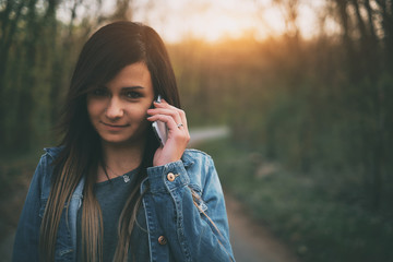 Cute brunette young girl talking mobile phone