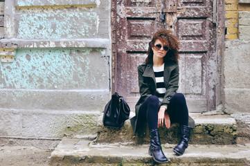 Stylish beautiful brunette woman wearing sunglasses with jacket