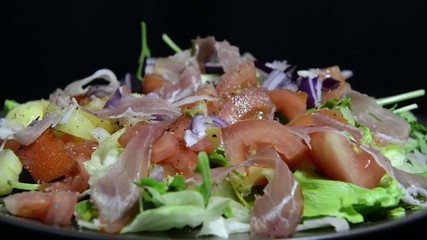 green salad with tomatoes and ham