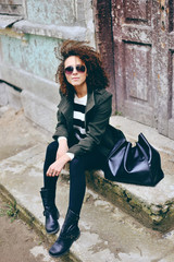 Stylish beautiful brunette woman wearing sunglasses with jacket