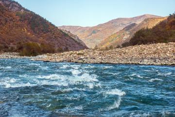 autumn landscape mountain river North Caucasus