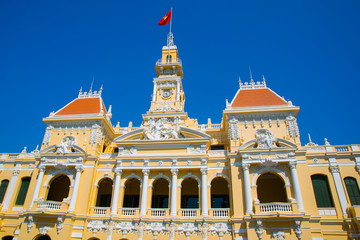 Building in the city with the flag of Vietnam