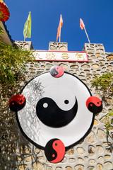 Ying yang symbol on chinese stone wall.
