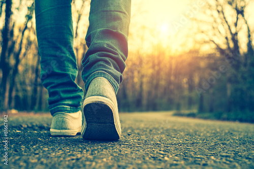 Woman jeans and sneaker shoes poster
