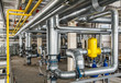 interior industrial gas boiler with a lot of piping, pumps and v