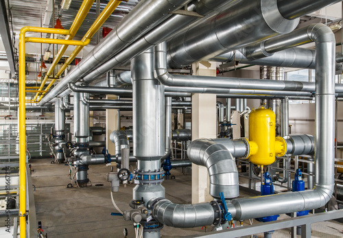 Staande foto Industrial geb. interior industrial gas boiler with a lot of piping, pumps and v