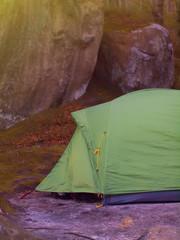 Tent under rocks.