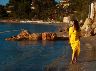woman with yellow dress on a  beach.
