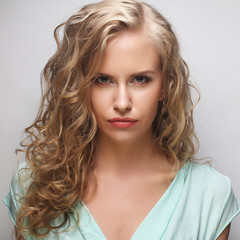 Portrait of young sensual blond woman.