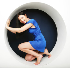 brunette in blue dress sitting in a circle