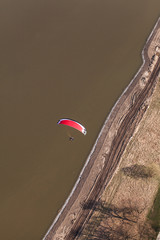 aerial view of paramotor flying over the river
