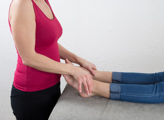 Young woman relaxing with foot massage