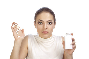 Young woman showing question mark made from pills
