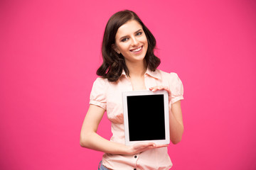 Yougn happy woman showing blank tablet computer