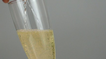 White wine poured into a glass