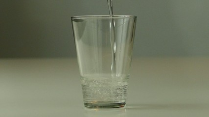 Pouring glass of water in slow motion
